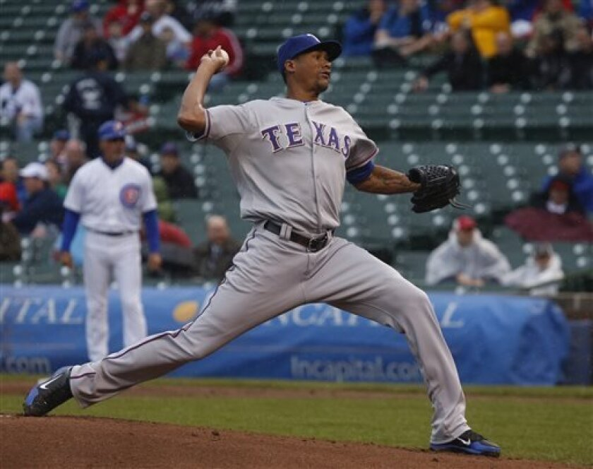 Texas Rangers starting pitcher Alexi Ogando delivers during the first inning of a baseball game against the Chicago Cubs Thursday, April 18 2013, in Chicago. (AP Photo/Charlie Arbogast)