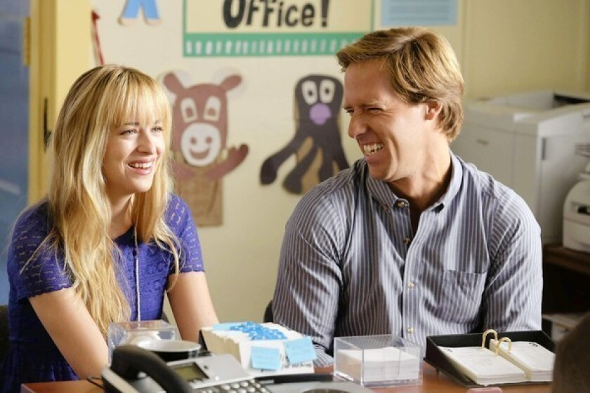 """Nat Faxon, as Ben, and Dakota Johnson, as Kate, in a scene from """"Ben and Kate."""""""