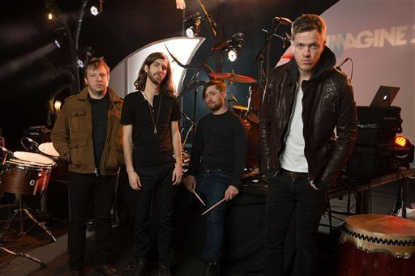 "In this Feb. 6, 2013 photo, Las Vegas-based rock band Imagine Dragons, from left, Ben McKee, Wayne Sermon, Dan Platzman and Dan Reynolds pose for a group portrait in Las Vegas. The band's debut album ""Night Visions,"" has reached gold status and features the hits ""It's Time"" and ""Radioactive."" The foursome, signed to music producer Alex da Kid's label imprint, is currently on a U.S. tour. (Photo by Al Powers/ Powers Imagery/Invision/AP)"