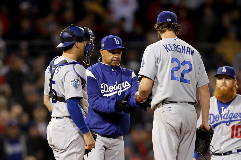 Manager Dave Roberts #30 removes Clayton Kershaw #22 of the Los Angeles Dodgers from the game during the fifth inning against the Boston Red Sox in Game One of the 2018 World Series at Fenway Park on October 23, 2018 in Boston, Massachusetts.