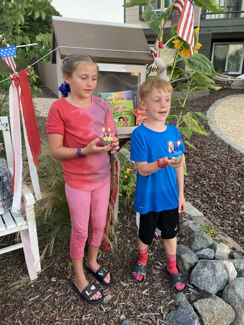 Violette and Hudson Marsolais, ages 8 and 6, help plan July Fourth community parade