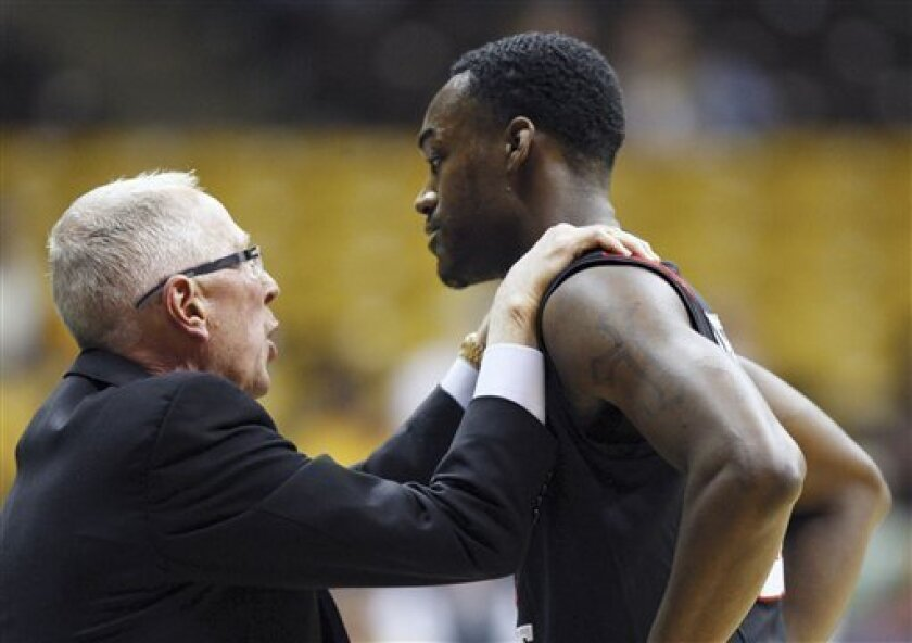 San Diego State coach Steve Fisher, left, talks with guard Jamaal Franklin during a 2011 game. (AP Photo/Laramie Boomerang, Andy Carpenean)