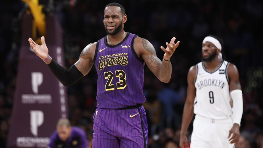 Lakers' LeBron James (23) reacts to a call against the Brooklyn Nets in the first half.