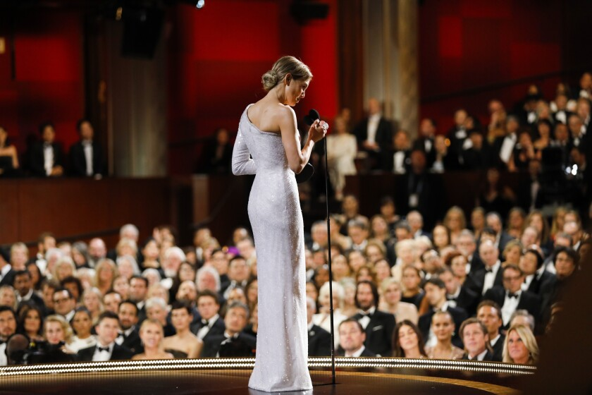 """Renée Zellweger accepts the Oscar for best actress for the film """"Judy."""""""