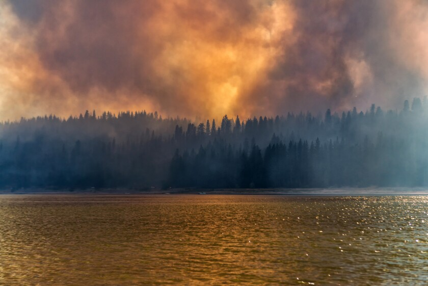 Wildfires choke the air with smoke near Yosemite in 2014. According to a report by the American Lung Assn., the state's drought increases the chance of fires, which worsen air quality in the short term.