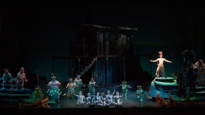 """Baritone Luis Alejandro Orozco, right, leads a scene where the jungle creatures join in song in San Diego Opera's """"Florencia en el Amazonas"""" at the San Diego Civic Theatre."""