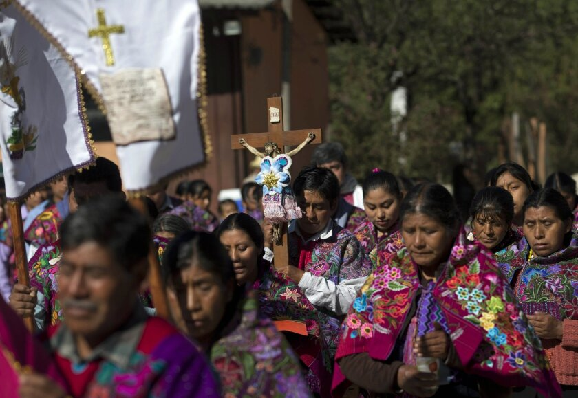 In this Jan. 16, 2016 photo, Tzotzil Indians participate in the procession in honor of the Christ of Esquipulas in Chajtoj, Chiapas state, Mexico. Pope Francisí visit to the heavily indigenous Mexican state of Chiapas appears aimed at celebrating the regionís ìIndian church,î a mix of Catholicism a