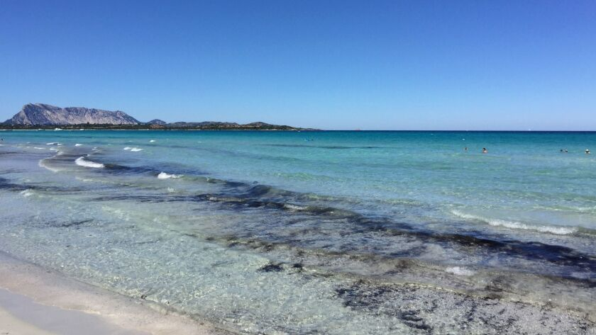 The town of San Teodoro on the island of Sardinia.La Cinta, a local beach that takes the form of an