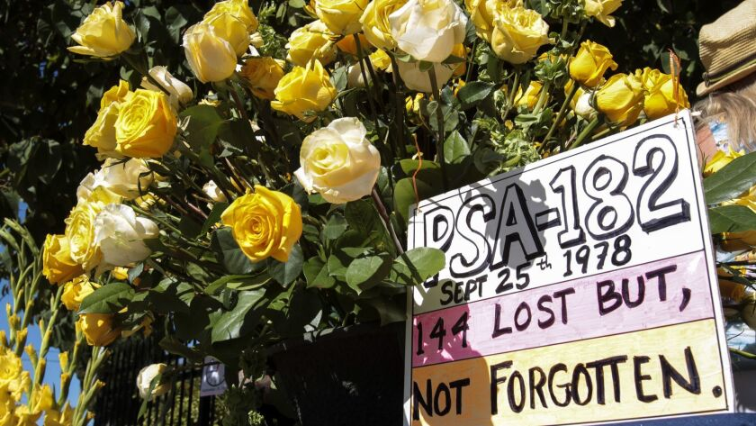 SAN DIEGO , September 25, 2016   A bouquet of flowers and a message during a memorial ceremony marki
