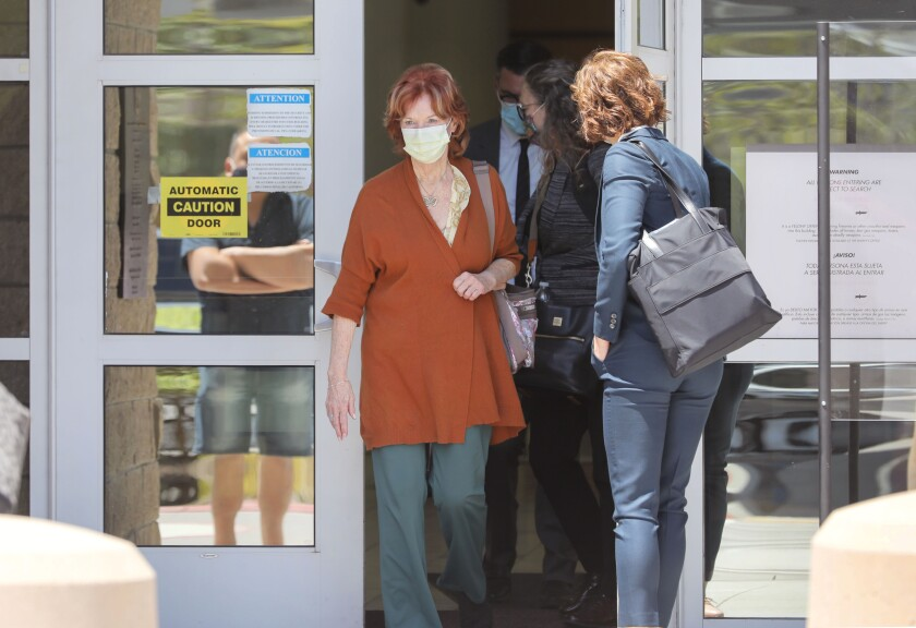 Jane Dorotik exits the Vista Courthouse at lunchtime with members of her legal team during her preliminary hearing