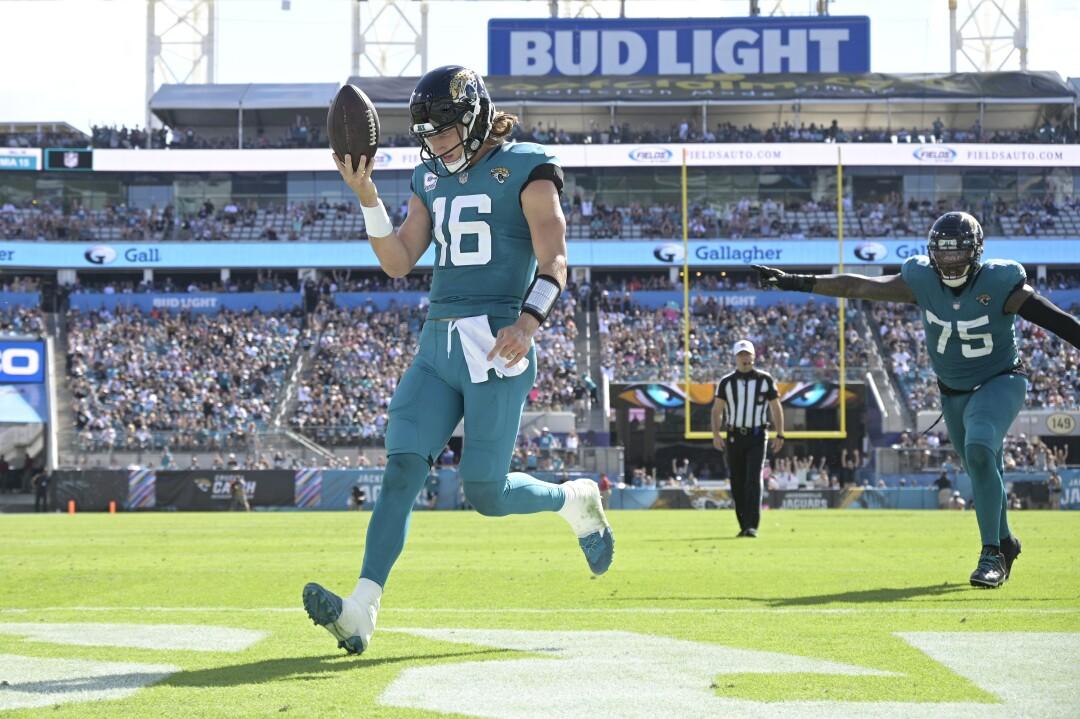 Jacksonville Jaguars quarterback Trevor Lawrence celebrates his 4-yard rushing touchdown.