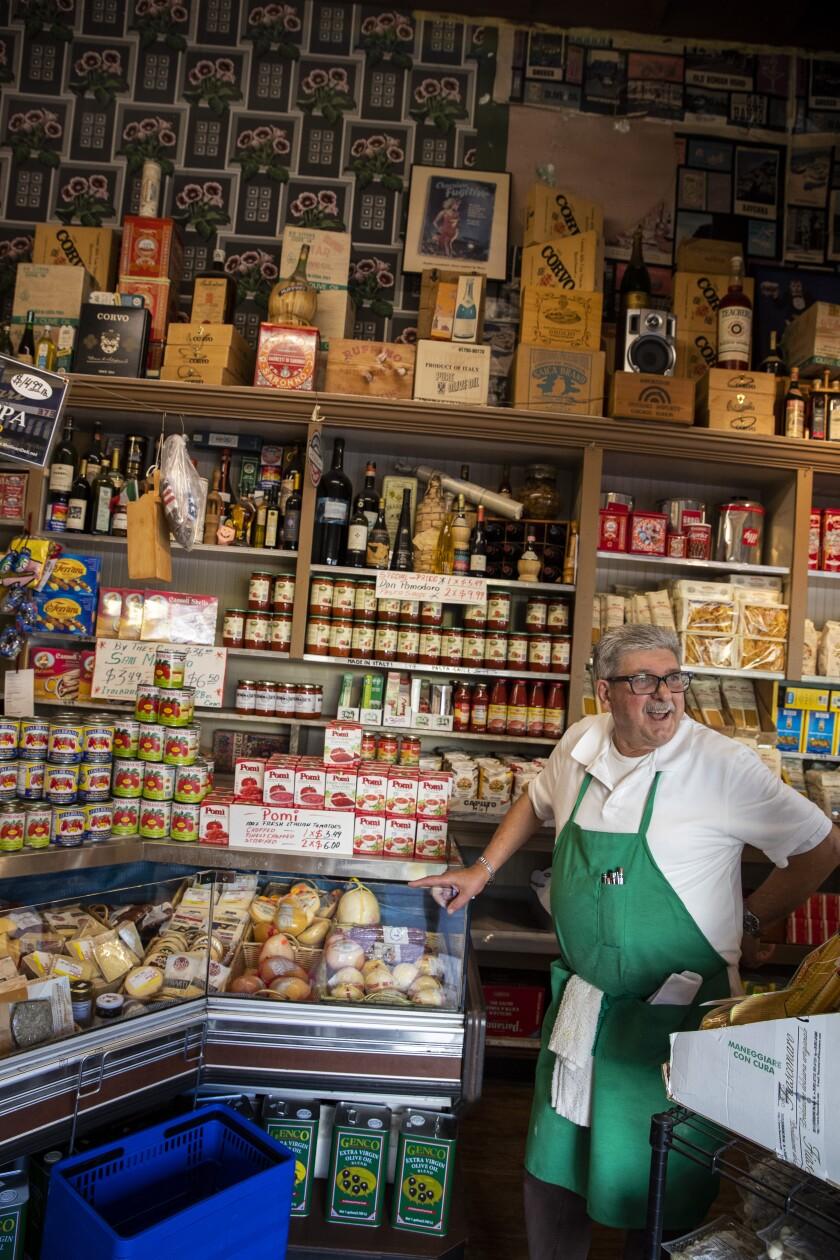 Franco Crivello stands ready to help customers at Molinari Delicatessen.