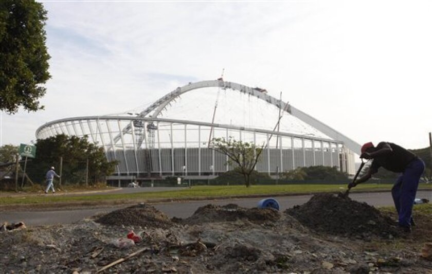 Labourers work to build Moses Mahiba Stadium in preparation for the 2010 Soccer World Cup in Durban, South Africa, Saturday May 16, 2009. (AP Photo/Aman Sharma)
