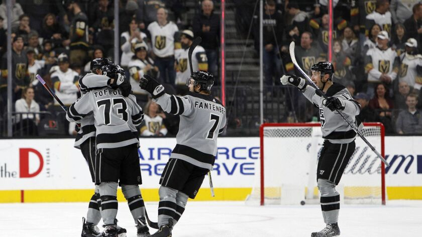 Kings right wing Tyler Toffoli (73) is congratulated by teammates after scoring the game-winning goal in overtime against the Vegas Golden Knights on Dec. 23, 2018, in Las Vegas.