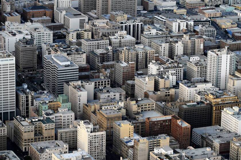In downtown Los Angeles, thousands of people live and work in concrete buildings, many of which have not been retrofitted.