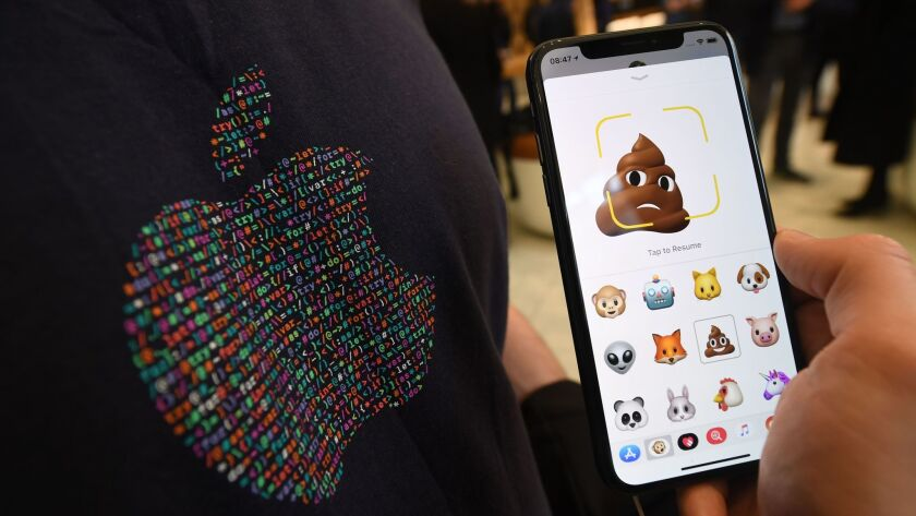 Emojis are shown on an Apple iPhone X.