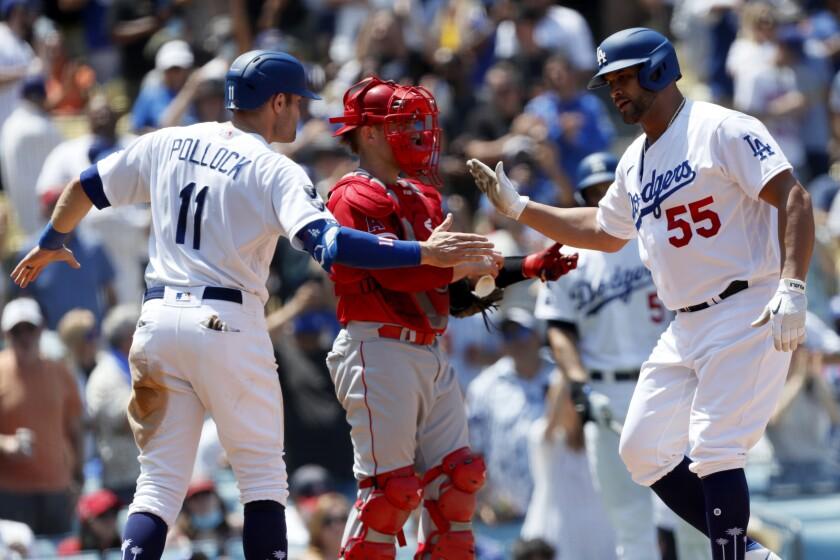Albert Pujols, right, celebrates his two-run home run with Dodgers teammate AJ Pollock.