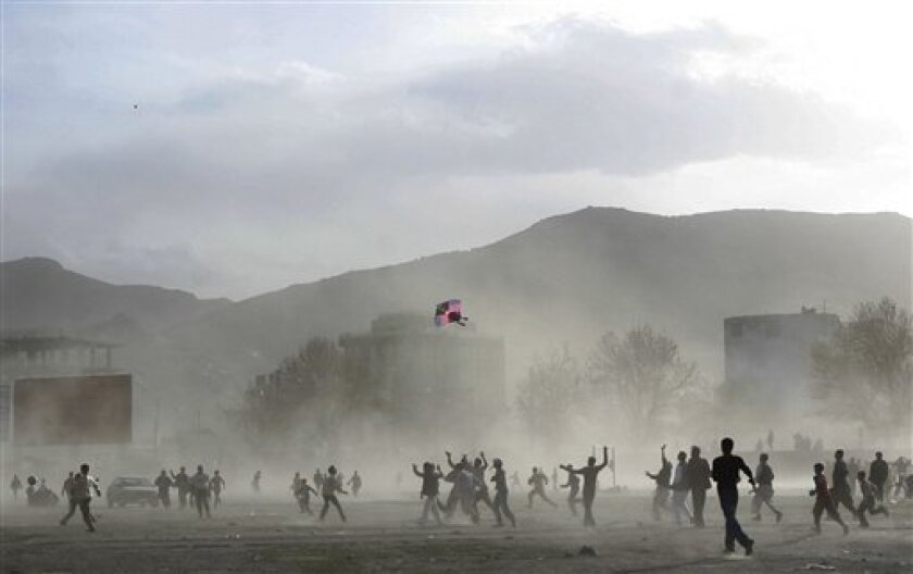 FILE - This March 28, 2009 file photo shows Afghan boys running after a kite during a kite flying competition to mark the Afghan New Year in Kabul, Afghanistan. (AP Photo/Musadeq Sadeq, File)