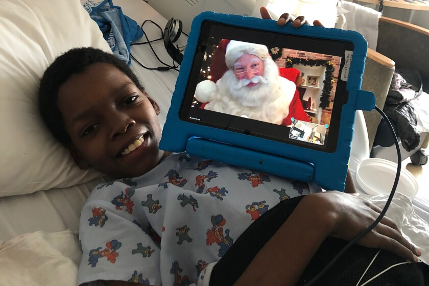 Patient Armonte Johnson visits with Santa via Zoom at UCLA's Mattel Children's Hospital on Christmas Eve.