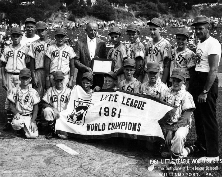 Members of the 1961 Northern Little League team posed with the championship plaque with commissioner John Lindemuth. VANNUCCI PHOTO SERVICES
