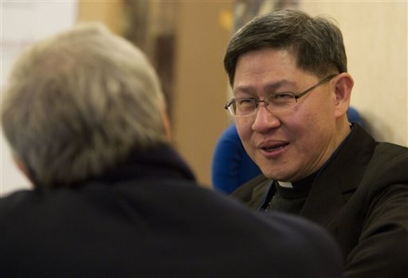The archbishop of Manila, Philippines, Luis Antonio Tagle, right, talks to a journalists during a break at the Vatican-backed symposium on clerical sex abuse, in Rome, Thursday, Feb. 9, 2012. Tagle said that a culture of silence prevalent on the Asian continent has kept many victims from coming forward, as concerns rise that Asia may be the next ground zero in the abuse scandal. (AP Photo/Andrew Medichini)