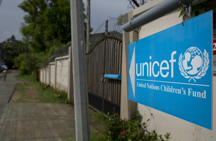 A sign board gives directions to the office of UNICEF in Yangon, Myanmar. (AP file/Gemunu Amarasinghe)