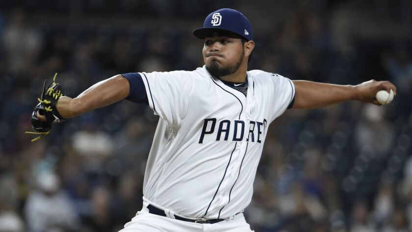 Jose Castillo pitches during the eighth inning Saturday night in his major league debut.