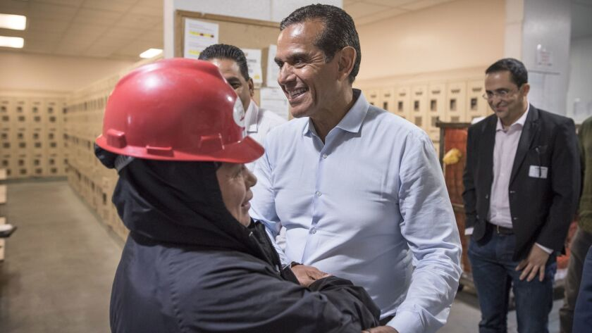Antonio Villaraigosa greets workers at the Organic Girl lettuce processing plant in Salinas during a