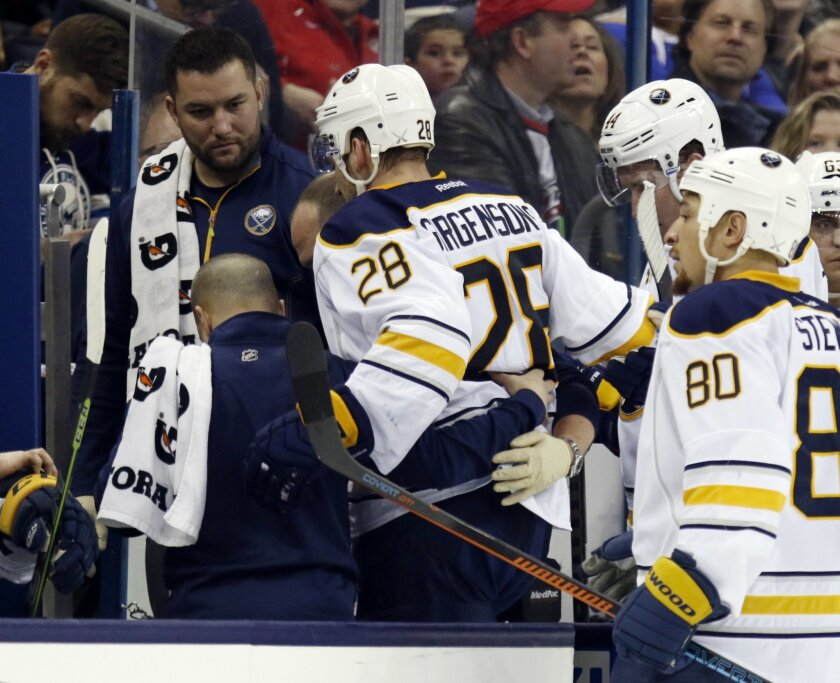 Buffalo Sabres' Zemgus Girgensons (28), of Latvia, is helped off the ice during the second period of an NHL hockey game against the Columbus Blue Jackets in Columbus, Ohio, Tuesday, Feb. 24, 2015. Buffalo won 4-2. (AP Photo/Paul Vernon)