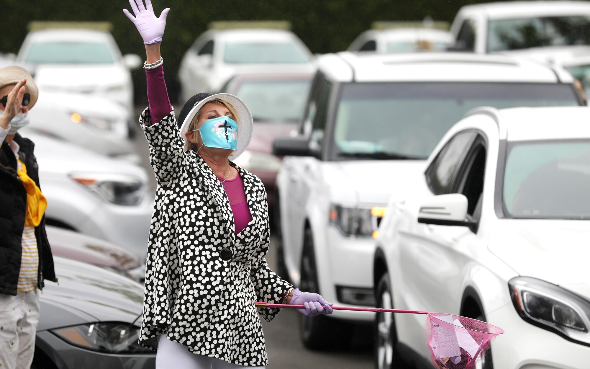 MaryAnn Lawson collects prayer requests in a Santa Ana parking lot.