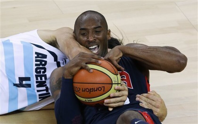 United States' Kobe Bryant, right, and Argentina's Luis Scola (4) scramble for a loose ball during a men's basketball semifinal game at the 2012 Summer Olympics, Friday, Aug. 10, 2012, in London. (AP Photo/Victor R. Caivano)