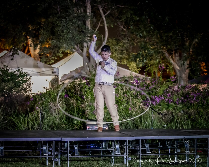 A student from Thee Academy performs floreo de soga, or traditional rope tricks.