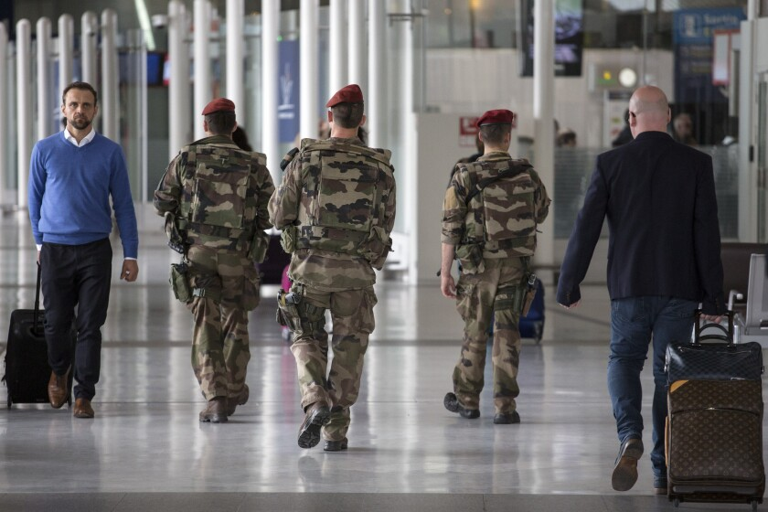 French soldiers patrol at Charles de Gaulle airport on Friday.