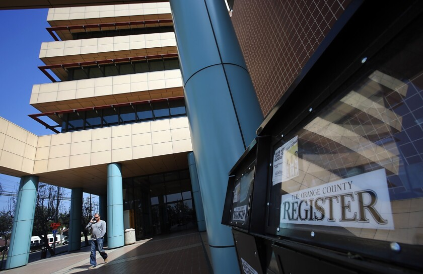 Freedom Communications Inc. is showing signs of financial distress. The parent company of the Orange County Register, whose headquarters are shown, is expected to announce layoffs Monday.