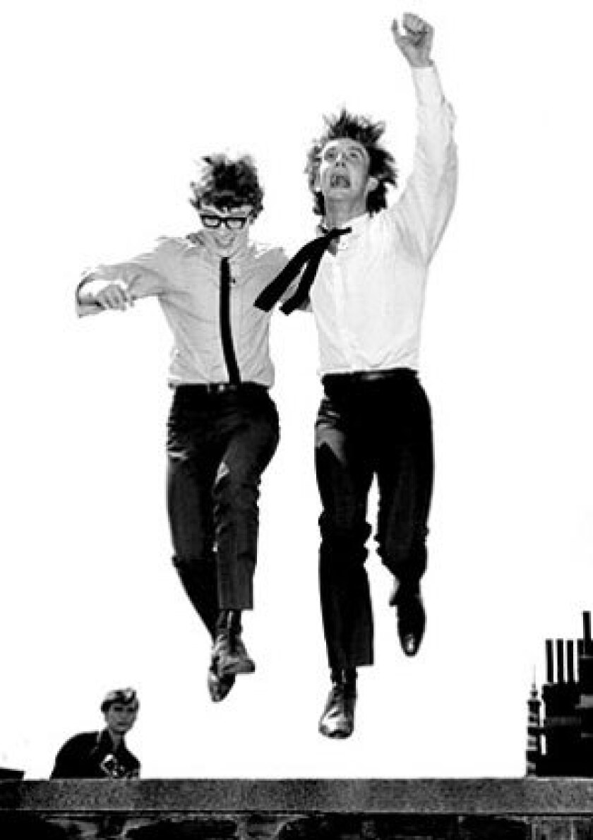In this July 28, 1964, file photo, British pop singers Peter Asher, left, and Gordon Waller leap in the air upon their return to London after a successful U.S. tour. Waller died Friday, July 17, 2009. He was 64.