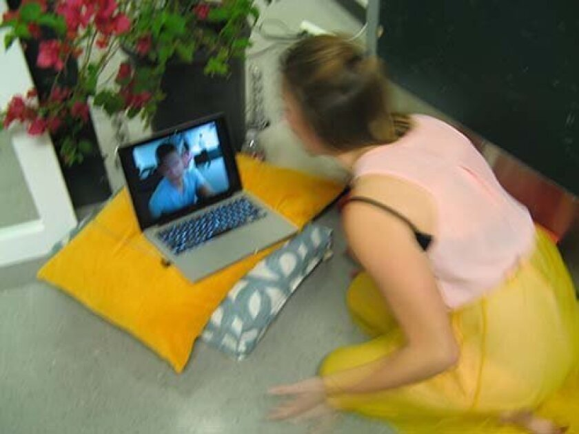 """In """"A Willow Grows Aslant,"""" Ophelia begs for her brother Laertes' attention via webcam chat."""
