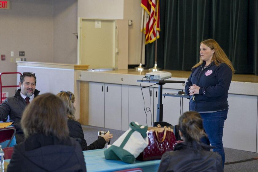 Principal Abby Domingo welcomes career day volunteers to Ashley Falls School