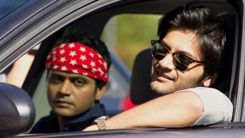 "Amitosh Nagpal, left, and Ali Fazal in ""For Here or to Go?"""