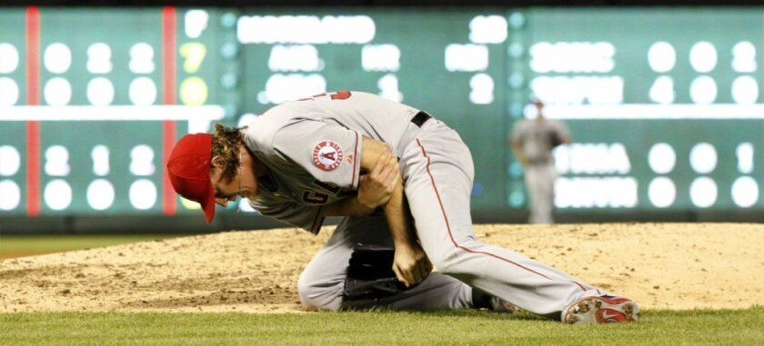 Jered Weaver out at least four weeks with broken left elbow