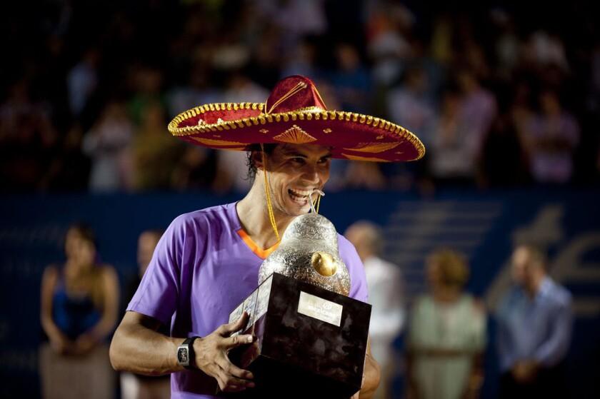 Rafael Nadal celebra tras coronarse en el Abierto Mexicano 2013.