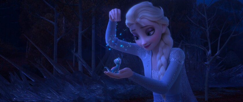 """Queen Elsa holds Bruni, a salamander who inhabits the Enchanted Forest of """"Frozen 2."""""""