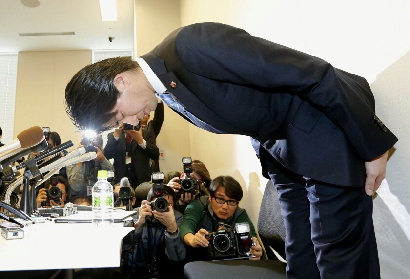 Japanese lawmaker Kensuke Miyazaki of ruling Liberal Democratic Party, bows during a news conference in Tokyo, Friday, Feb. 12, 2016. Miyazaki, a married Japanese ruling party lawmaker resigned Friday for allegedly having an affair while publicly announcing he would seek to take paternity leave to