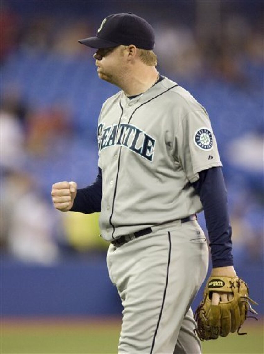 Seattle Mariners pitcher J.J. Putz pumps his fist after defeating the Toronto Blue Jays 3-2 in the 10th inning in a baseball game in Toronto on Monday June 9, 2008. (AP Photo/The Canadian Press, Frank Gunn)