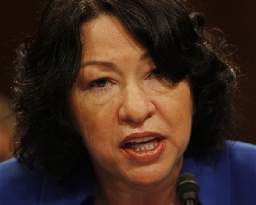 FILE - Supreme Court nominee Sonia Sotomayor gives her opening statement on Capitol Hill in Washington, in this July 13, 2009 file photo taken during her confirmation hearing before the Senate Judiciary Committee. The National Rifle Association now has added a lesser-known strategy to protect its interests: opposing President Barack Obama's judicial nominees whom it sees as likely to enforce gun-control laws. In some cases, the group's opposition has kept jobs on federal benches unfilled. The NRA opposed both Sonia Sotomayor and Elena Kagan and warned its allies in Congress that their votes to confirm each would be held against them. (AP Photo/Ron Edmonds, File)