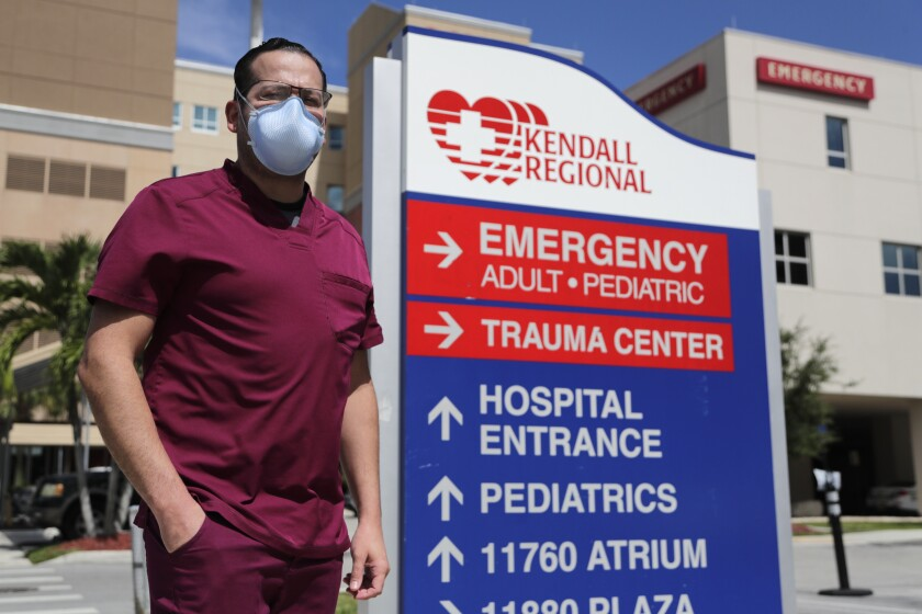 Nurse Rublas Ruiz outside Kendall Regional Medical Center where he works in the  intensive care unit.