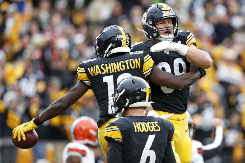 Pittsburgh Steelers wide receiver James Washington (13) celebrates with tight end Vance McDonald (89) after making a touchdown catch from Steelers quarterback Devlin Hodges (6) during the first half of an NFL football game against the Cleveland Browns, Sunday, Dec. 1, 2019, in Pittsburgh. (AP Photo/Don Wright)