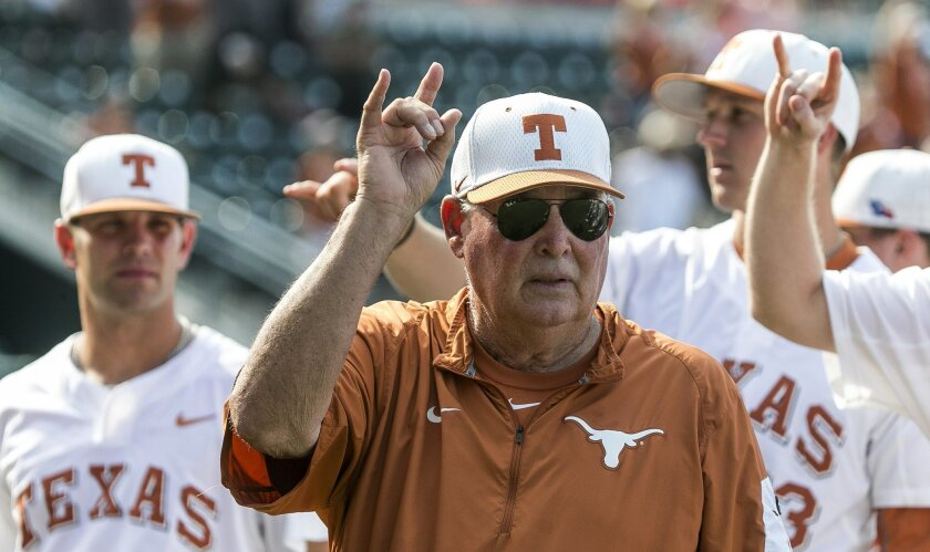 """FILE - In this Saturday, May 21, 2016, file photo, Texas coach Augie Garrido sings """"The Eyes of Texas"""" with the team after Texas defeated Baylor 7-6 in an NCAA college baseball game in Austin, Texas. Garrido, the winningest coach in college baseball history, is out after 20 seasons at Texas. The de"""