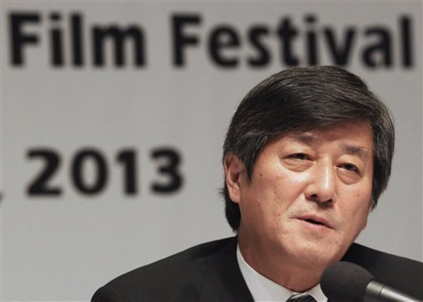 Lee Yong-kwan, director of the Busan International Film Festival, speaks during a press conference in Seoul, South Korea, Tuesday, Sept. 3, 2013. The festival will be held at the Busan Cinema Center and seven other movie theaters in the southern port city of Busan from Oct. 3-12.(AP Photo/Ahn Young-joon)