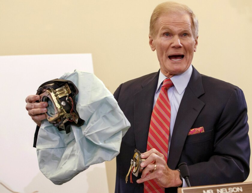 FILE - In this Nov. 20, 2014 file photo, Senate Commerce Committee member Sen. Bill Nelson, D-Fla. holds an example of the defective airbag made by Takata of Japan that has been linked to multiple deaths and injuries in cars driven in the U.S. during the committee's hearing on Capitol Hill in Washi