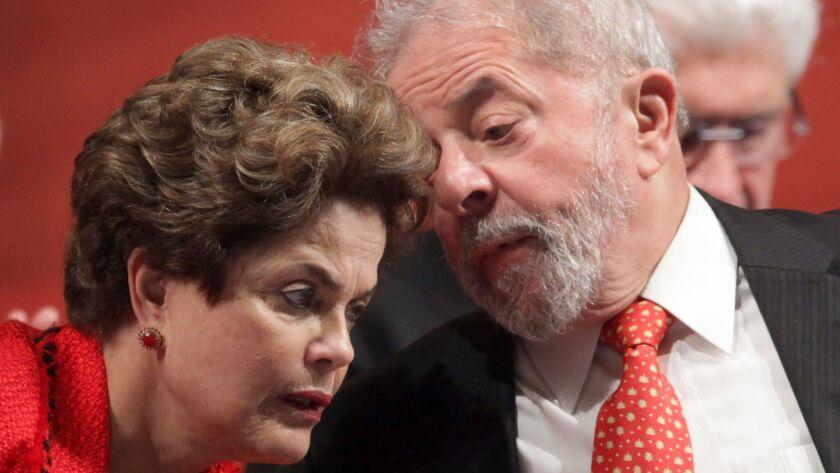 Former Brazilian President Luiz Inacio Lula da Silva, right, and his ousted successor, Dilma Rousseff in July.